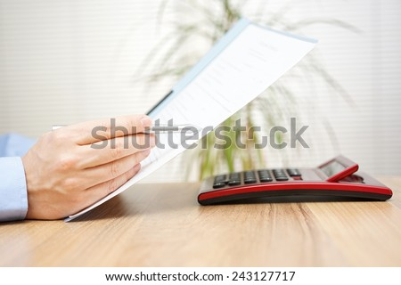 businessman is reading and checking contract