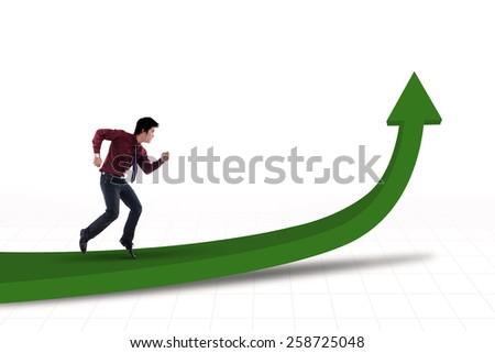 Businessman is running on profit line chart - stock photo