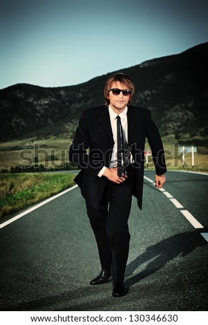 Businessman is running on the highway. Business struggle concept. - stock photo