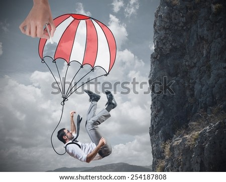 Businessman is saved from a fall deep - stock photo