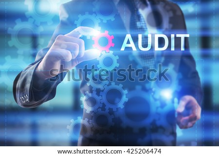 Businessman is selecting Audit on the virtual screen. - stock photo