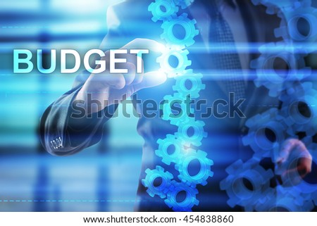 Businessman is selecting Budget on the virtual screen.