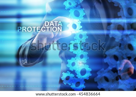 Businessman is selecting Data protection on the virtual screen.