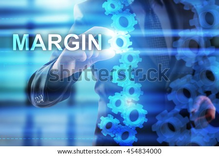 Businessman is selecting Margin on the virtual screen.