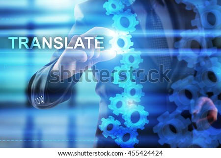 Businessman is selecting Translate on the virtual screen.
