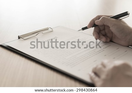 Businessman is signing a contract.  business concept