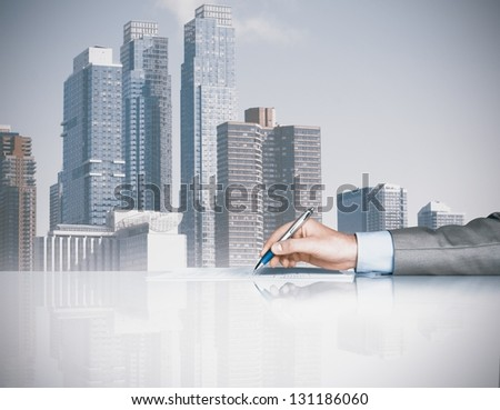 Businessman is signing a contract in office - stock photo