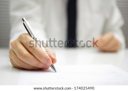businessman is signing contract - stock photo