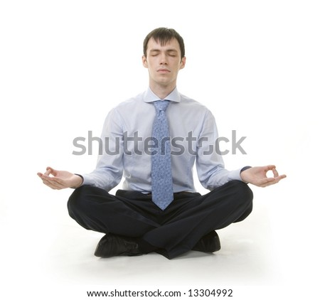 Businessman is sitting in yoga position