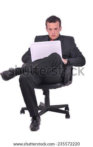 Businessman is sitting on the chair and checking his email
