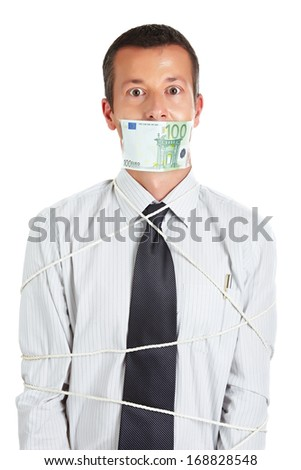 Businessman is slave to the money - stock photo