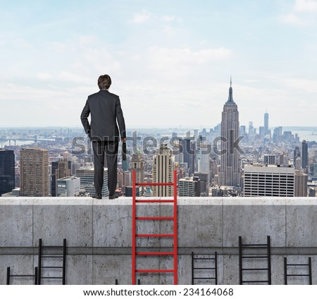 Businessman is standing on the top of a building. A concept of competition and problem solving. City view background.  - stock photo