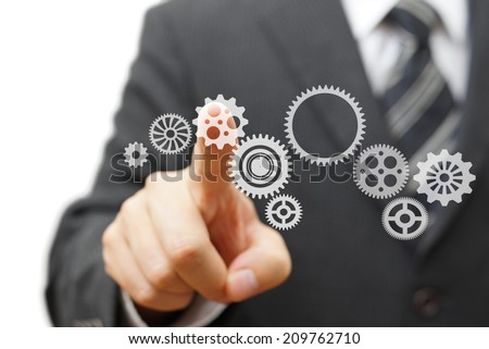 Businessman is touching virtual sprocket. Technology and Vision