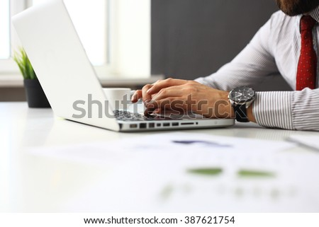 businessman is typing on keyboard