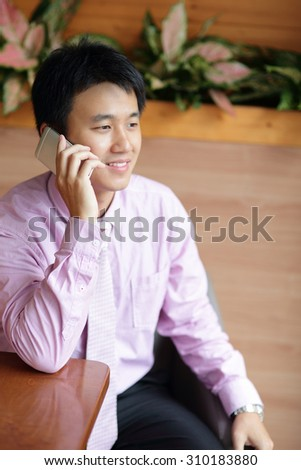 Businessman is using smartphone, asian - stock photo