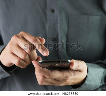 Businessman is using smartphone for communication and works