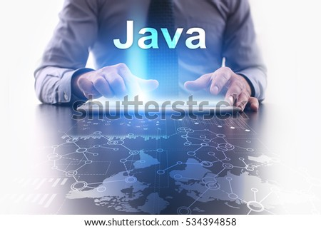 Businessman is using tablet pc and selecting java.