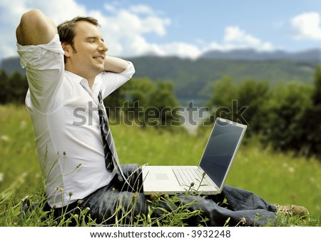 businessman is working and relaxing in the nature. Unique keyword for this collection is: naturebusiness77 - stock photo