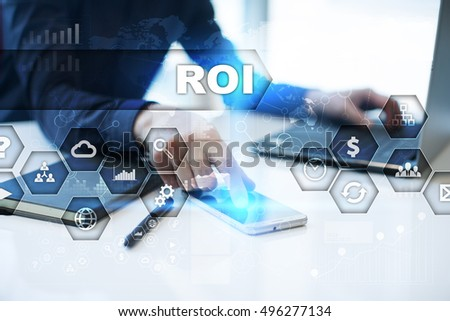 Businessman is working in office, pressing button on virtual screen and selecting roi
