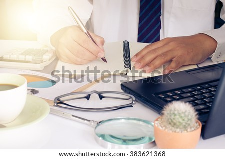 Businessman is working on a table with a functional device is placed.