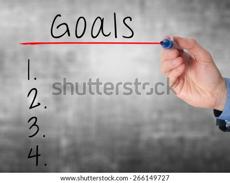 Businessman is writing goals list,  planning on whiteboard. Isolated on grey. Stock Image