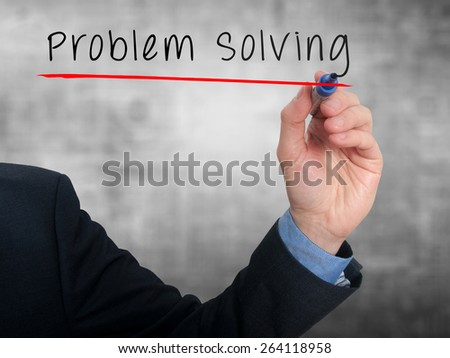 Businessman is writing Problem Solving on the transparent board. Isolated on grey background. Stock Photo - stock photo