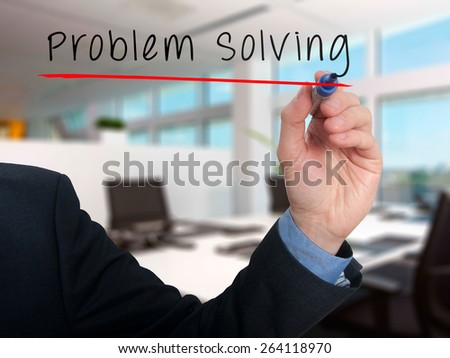 Businessman is writing Problem Solving on the transparent board. Isolated on office background. Stock Photo - stock photo