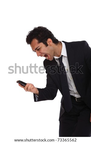 Businessman is yelling at his phone for not working - stock photo