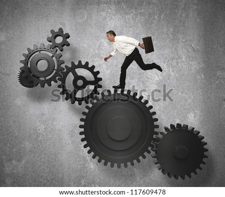 Businessman jump on gear system - stock photo