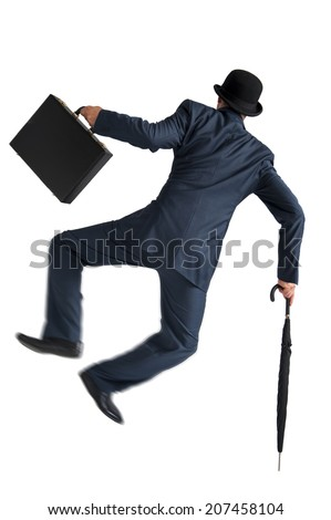 businessman jumping and kicking his heels isolated on white background - stock photo