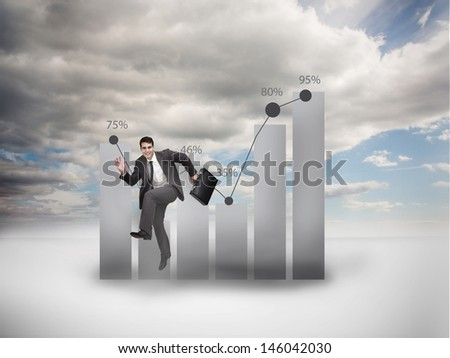 Businessman jumping next to a chart with blue sky on the background
