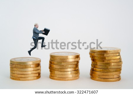 Businessman jumping on euro coin column