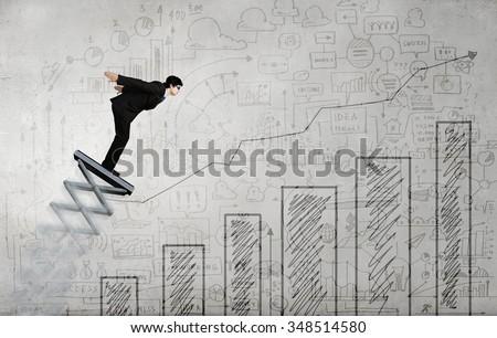 stock-photo-businessman-jumping-on-sprin