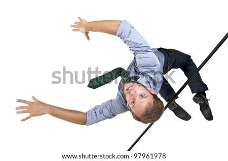 Businessman jumping over an Olympic high-jump bar - stock photo