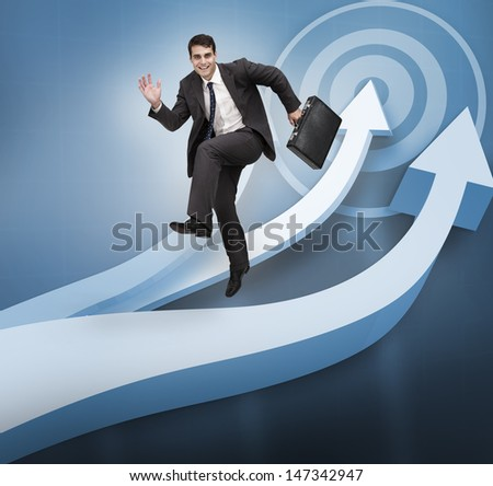Businessman jumping over blue arrows on the background