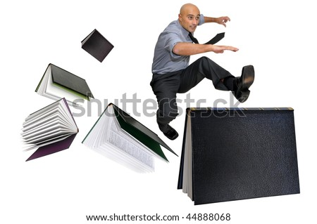 Businessman jumping over books isolated in white