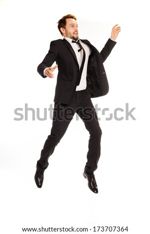 businessman jumping up on white - stock photo