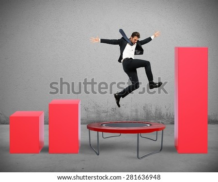 Businessman jumps on the trampoline between statistics - stock photo