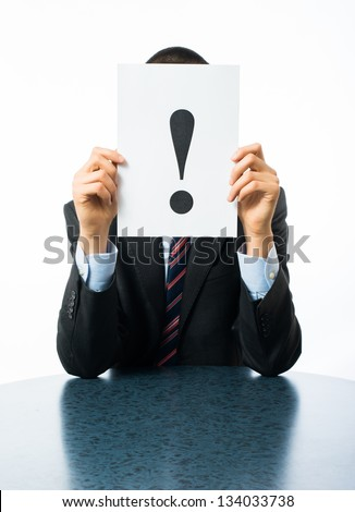 Businessman keeps exclamation mark - stock photo