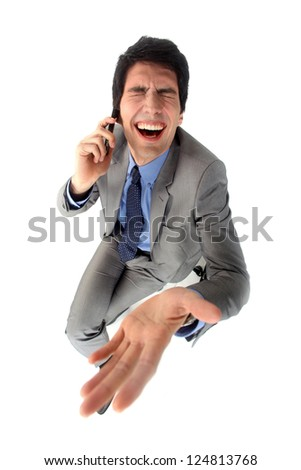 Businessman laughing hysterically - stock photo