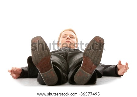 Businessman laying down in a suit isolated on white background - stock photo
