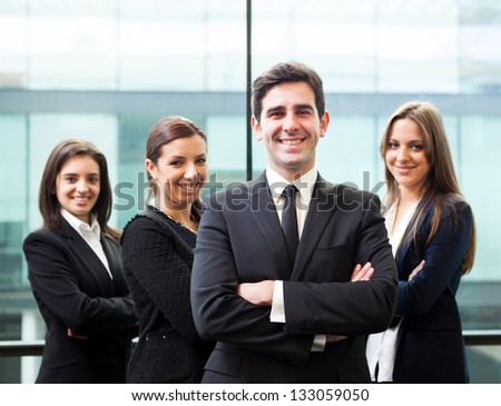 Businessman leader on the foreground of his team - stock photo