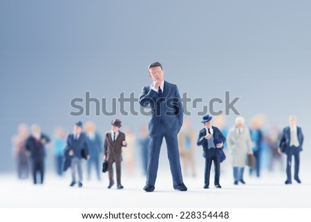 Businessman leading a big group of business people