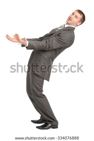 Businessman leaned back with empty hands and looking at camera on isolated white background