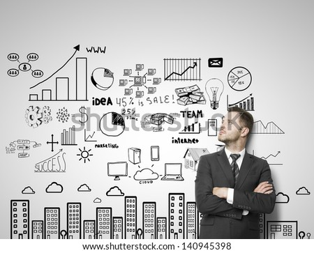 businessman leaning against a concrete wall  with city concept - stock photo