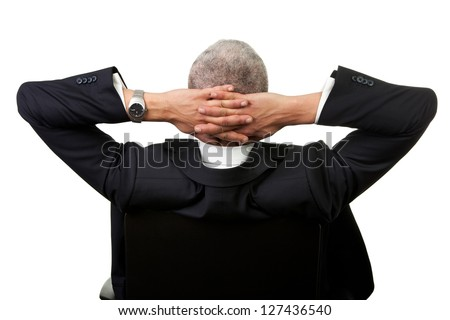Businessman leaning back in the chair. Isolated on white - stock photo
