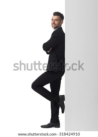 Businessman leaning on copyspace portrait isolated on white background  - stock photo
