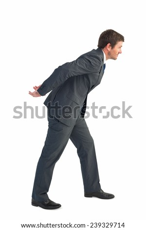 Businessman leaning over on white background