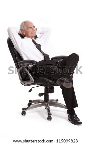 Businessman leans back in a chair - stock photo
