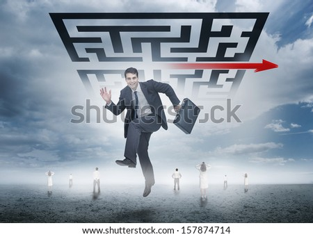 Businessman leaping happily in front of giant qr code with business people far below - stock photo